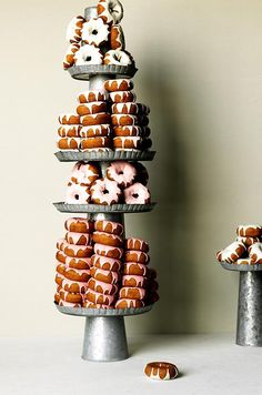 Indulge your sweet tooth in an unexpected way with a towering display of frosted donuts at your wedding. Find more non-wedding cake desserts for your big day!