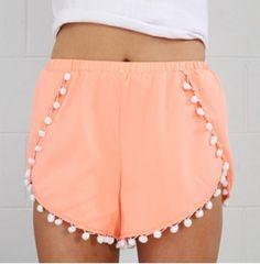 Beginning Boutique coral Pom-Pom shorts.
