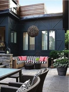 Balance a dark shade of home paint with bold colors and patterns for your outdoor living space decor. love love love this!!