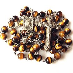 Im sorry due to the limit of my camera I cannot present the complete beauty of this bead to you. If you have the chance to get this Rosary please dont forget to admire it under light.This Rosary will become part of your life! If you have any questions or you need more information about this or any other product please email me.Please take a moment to browse through the other lovely jewelry items in my store and add me to your list of favorites.  Features  NICE Tiger Eye & Silver Rose Beads…