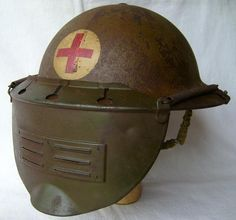 WWI helmet of a medic with a face guard.