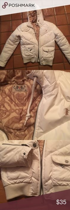 Juicy couture winter jacket Trendy white juicy couture winter jacket. Warm down jacket great for a cold night. Comes w snap on faux fur trip around the hood Juicy Couture Jackets & Coats
