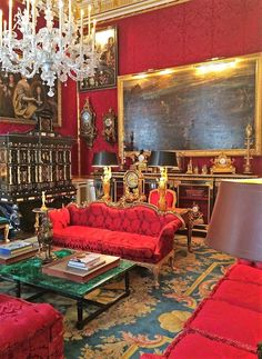 Red salon with a Renaissance cabinet.