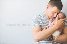 dad-holding-newborn-photo-by-Beth-Deschamp-840x561.jpg