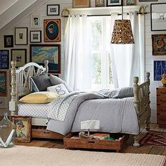 Very rustic for a boy's bedroom. Subtle pinstripe comforter on the bed. Love the hanging lamp and curtain treatment.