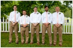 This look for the groomsmen in light grey pants and sage green ties