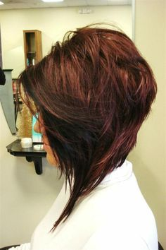 Short hair in back, long in front with layers for height
