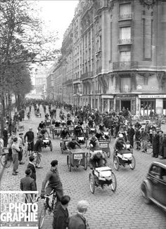 tricycles racing through the streets of Paris in 1940.