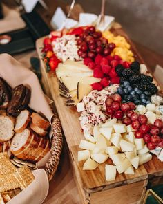 fruit + cheese board display wedding grazing station composed of assorted local cheeses, fresh fruits and berries Cheese Board Display, Sour Plum, Lunch Delivery, Greens Restaurant, Wedding Appetizers, Daily Specials, Hors D'oeuvres, Breakfast Burritos, Menu Items