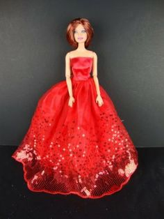 The Most Amazing Red Dress with Sequins Made to Fit the Barbie Doll by Olivia's Doll Closet. $6.75. Handcrafted Especially for Olivia's Doll Closet to fit the Barbie Doll. A great gift for your children ,your friends and yourself . check out our many other styles and colors. 100% Brand new  Size: Great for 30 cm Barbie dolls & other 30 cm dolls. Package includes: 1X Clothes (Doll not included, only the Clothes). Please note:   that all items are made for and or by Olivi...