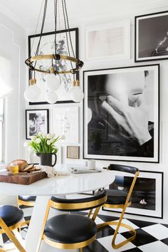 With an inviting living room space, with simplistic beige/white walls, and grey velvet seating, you wouldn't expect much from the Brady Tolbert's home. But, bring in the elegant light fixtures,...