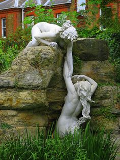 Two of several water nymph statues in York House Gardens Twickenham along side the River Thames and near Dial House Riverside -- The statues were Imported from Italy by a Whitaker Wright who following his conviction for fraud took his own life in court from cyanide in 1904 This led to Sir Ratan Tata an Indian grandee to aquire the statues and bring them into his gardens at York House - source - The Twickenham Museum