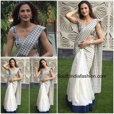 Shilpa Reddy looks elegant in white half chanderi and half malkha saree teamed with embroidered sleeveless blouse.  Related PostsElegant Designer Sarees by Shilpa ReddyCharmee in Shilpa Reddy SareeShilpa Reddy in Dhoti SareeShilpa Reddy in Elegant Saree