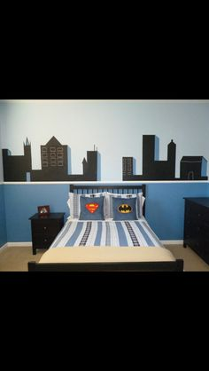 Superhero room with black chalkboard paint. EMC, I just like the concept for a paint job...it's pretty simple...I'd paint the top/bottom two different shades of blue or gray and then freehand some cool buildings.
