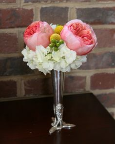 Pink garden roses and white hydrangea tussy mussy for mother of the bride