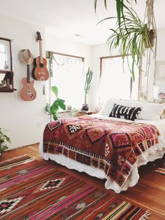 A little too boho, but I like the plain bedspread with a fun blanket. And plants of course