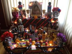 My 2013 Dia de Los Muertos Altar!  My altar consisted of everything my dearly departed loved ones enjoyed.  It's also full of vibrant colors.  Original Pinner: Chely SuperMom
