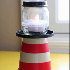 Simple lighthouse craft. Old baby food jars and small flower pots. Too cute!