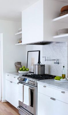 example of a white hood centered over stove/kitchen counter, shelves on either side.