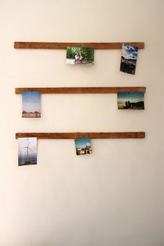 Scraps of wood with 3-4 nails in them, photos (etc.) hung on nails via paperclips. Cool idea.