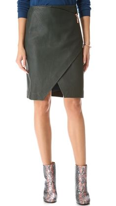Cedric Charlier Asymmetrical Leather SkirtA zipper cuts through the front of this Cedric Charlier leather skirt, giving the artfully crafted wrap silhouette a pop of cool metal. Hidden side zip. Lined.