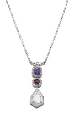 Sapphire, ruby and diamond pendent necklace The detachable pendant designed as an articulated line set with a cushion-shaped purple sapphire weighing 7.04 carats, a similarly cut ruby weighing 4.47 carats, and a modified kite portrait-cut diamond weighing 11.48 carats, each framed and bordered by a triple row of brilliant-cut stones, to a necklace composed of alternating brilliant-cut and baguette diamonds, length approximately 520mm.