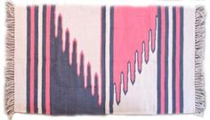 Designer Holly Dunlap works with The Malawi Council for the Handicapped to help provide jobs for local disabled residents. The African-based brand's Pink Zig Zag Rug features a bold hand-loomed pattern that is sure to enliven any room