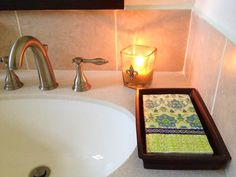 Do it Yourself - Give guests the option of a fresh dry hand towel using napkins (6.00/pack) and a display tray (10.00). Chic and easy!  Mirab's Home Store & Furniture Gallery!