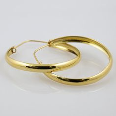 Items similar to Bold retro, yellow gold hoop earrings on Etsy Gold Hoop Earrings, Gold Hoops, Vintage Jewelry, Unique Jewelry, Bangles, Bracelets, Unique Vintage, Solid Gold, My Etsy Shop