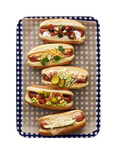 Hot Dog Topping Ideas - Greek Dog, Asian Dog, Bourbon Street Dog, Taco Dog and Reuben Dog.  For a Around The World party I would label these dogs as Greek, Asian, Mexican, Russian, and add American.