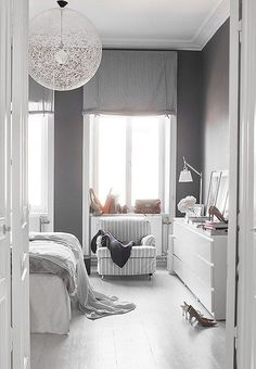 """Gray walls add depth and contrast to this all-white room, while bold light fixtures make it modern. Read more and see them all on """"Our Favorite (Almost) All-White Rooms"""" over on our Style Guide! All White Room, White Rooms, White On White, Grey Room, Home Bedroom, Bedroom Decor, Teen Bedroom, Master Bedroom, Bedroom Curtains"""