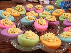 Easter Colored Deviled Eggs--SO EASY!  after boiling and peeling the eggs just yolk them and dye the whites like you normally would when dying eggs! I used an icing piper to fill with the yolk mixture! :)