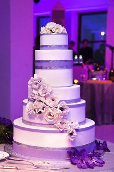 {Bridal Cakes} Glitter & white 5 tier wedding cake with white rose detail #bridal #wedding #weddingcake