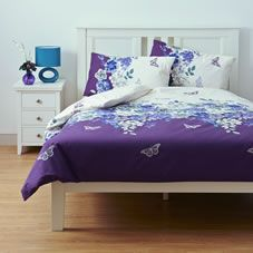 Snuggle up in style with this purple double duvet set with intricate floral…