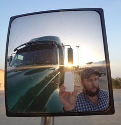 "This undated image provided by James Weitze shows a truck driver taking a self portrait on the road. Weitze satisfies his video fix with an iPhone. He sleeps most of the time in his truck, and has no apartment. To be sure, he's an extreme case and probably wouldn't fit into Nielsen's definition of a household in the first place. But he's watching Netflix enough to keep up on shows like ""Weeds,"" ""30 Rock,"" ""Arrested Development,"" ""Breaking Bad,"" ""It's Always Sunny in Philadelphia"" and ""Sons…"