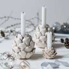 Create a wonderful table decoration with the sisters' pine cone-shaped candleholders. Available in two colours and two sizes. Price per item from DKK 29,90 / EUR 4,19 / ISK 819 / NOK 43,80 / GBP 3,98 / SEK 42,80 / CHF 6,34 / FO-DKK 35,03 / JPY 468