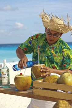 Entertaining Caribbean activities offered at the pool at Ritz Carlton Cancun #Coconut drink