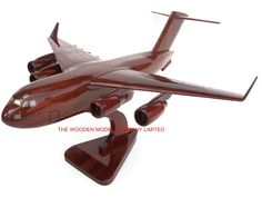 """A beautiful hand carved desktop model of the C17 Globemaster. The model has been carved from solid mahogany. The model comes boxed and is simple to assemble. The wings, tail fins and stand simply slot into pre-drilled holes on the body of the aircraft. No glue required. Size H 10"""", L 18"""", W 17"""". Visit our website at thewoodenmodelcompany.co.uk to view the full range of our models."""