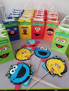 Sesame Street Package includes the following. - Happy Birthday banner and 2 images on pennants - 25 gift bags total, with 5 different faces that include, 5 Elmo, 5 Bert, 5 Ernie, 5 Oscar, 5 Grover. And (childs name) Street. - 3 sets of Big bird, Cookie Monster, Elmo (with one for first