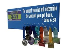 """Race bibs and medals hanger - """"The amount you give will determine the amount you get back."""" -Luke 6:38 - $39.99"""