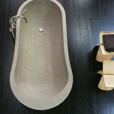 Concrete tub with Sori Yanagi Butterfly Stools