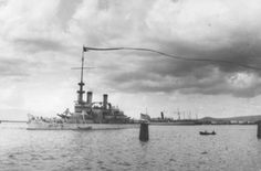The battleship USS Oregon (BB-3) departs Honolulu for San Francisco in 1905. The long pennant flying from her mast signifies a ship returnin...