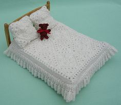 This pattern is from my first collection of miniature knitting patterns for the doll's house in 1:12 Scale. The tiny bedcover and cushions are easy to knit with scraps of yarn.