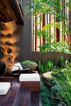 dark wooden deck in modern small garden design  | adamchristopherdesign.co.uk
