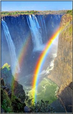 Double rainbows and streams of water seem to follow the same path at Victoria Falls, arcing downward to the Zambezi river 360 feet below. Taken at the far end of the falls, this looks across to the Zambian portion of the park. It was shot at the point in yesterday's picture, shown in comments below, where the river exits the fissure and turns into the canyon going under the bridge. We saw people at the bottom, and had no idea how they got down there.