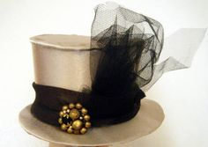 Instructions on how to make a Mini Top Hat to go with your Halloween costume...or maybe just to wear anytime since they are so darn cute.