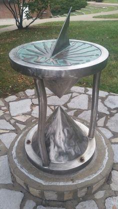 Sun dial/ hourglass sculpture near memorial hall