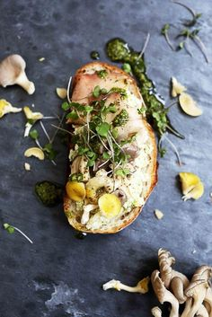 Pickled mushroom crostini topped with microgreens and edible rose petals.