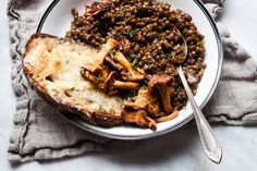 This recipe is one you will make over and over. We love French lentils for their small size and peppery bite, and this combination of lentils, thyme, wine, and
