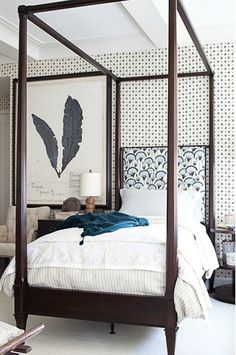 Mixed patterns, bold artwork and bed frame.